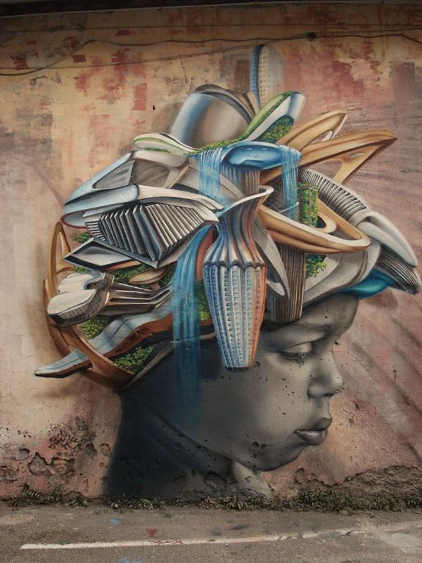 Un mural donde se ve la cara de una mujer de medio lado y tiene varias cosas de cocina sobre su cabeza