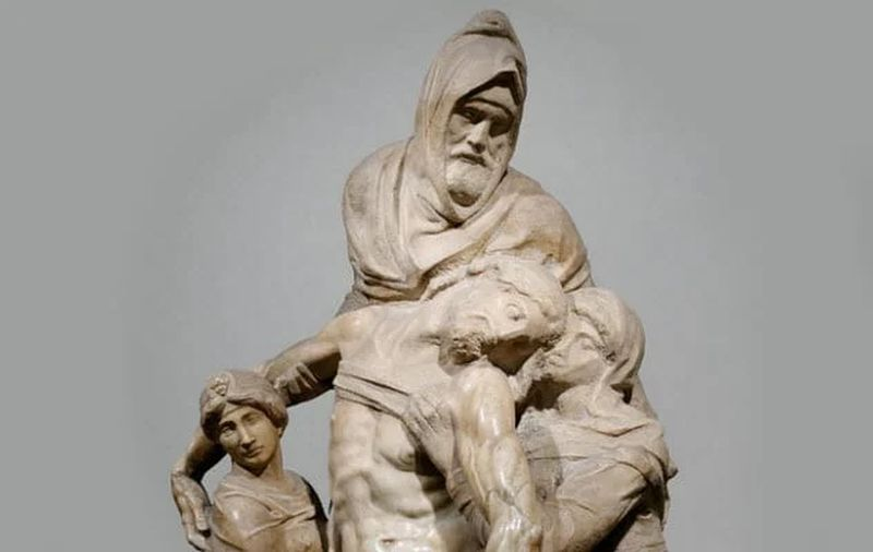 Tres personas sosteniendo a Jesús mientras lo vendan