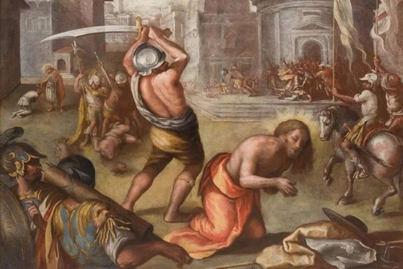Un hombre con una espada a punto de cortar la de un hombre arrodillado en frente suyo  y atras uno ya decapitado