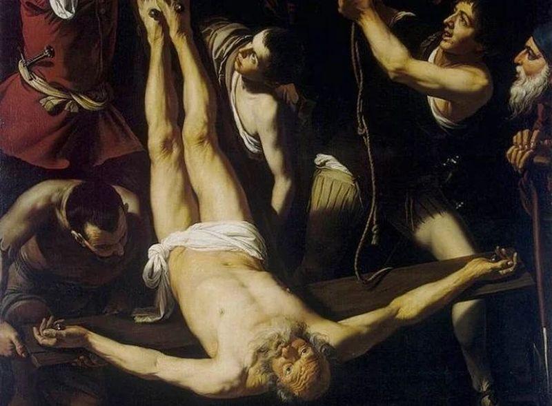 Varios hombres alrededorde un hombre puesto e4n una cruz alrevés