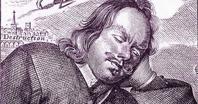 Hombre con bigote y pelo largo con los ojos cerrados