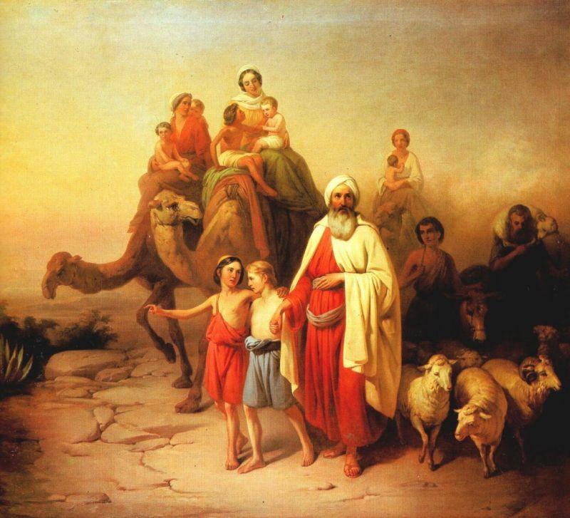 Un grupo de personas con camellos y ovejas