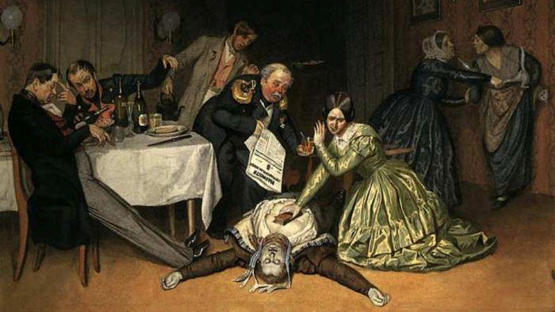 Hombre tirado en el suelo de un color diferente al normal y alrededor más personas preocupadas