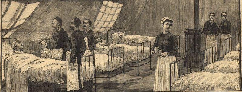 Varias personas en camilas y a su alrdedor enfermeras