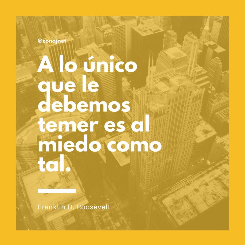 El centro de una gran ciudad con rascacielos visto desde el aire y un mensaje sobre el temor