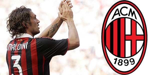 Un jugador de futbol numero tres uniforme de rayas con su pelo largo empapado que aplaude muy alegre